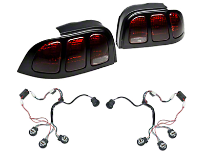 Raxiom Smoked Tail Lights and Sequential Combo (94-98 All)