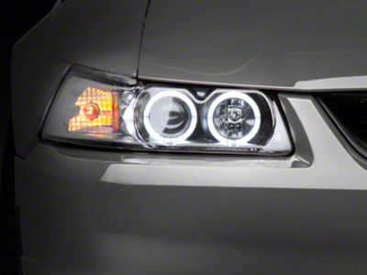 Raxiom Black Projector Headlights - Dual LED Halo (99-04 All)