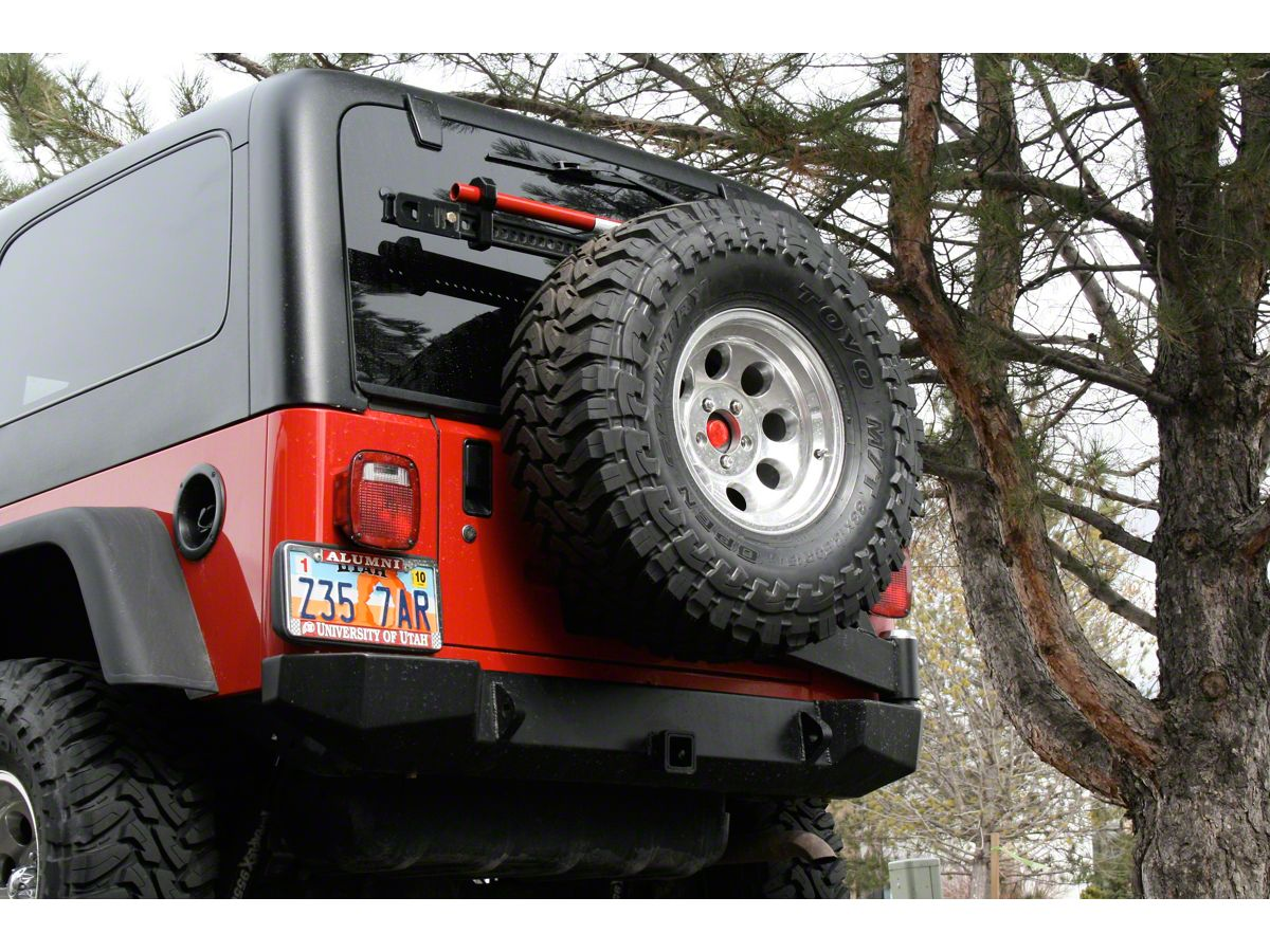 Expedition One Jeep Wrangler Rear Bumper w/ Tire Carrier - Textured Black  TJ_RB100STC_PC (97-06 Jeep Wrangler TJ) | White Jeep Sahara Lifted With Tire Carrier And Led Tail Lights |  | Extreme Terrain