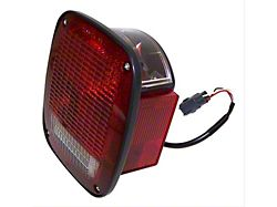 Tail Light; Chrome Housing; Red/Clear Lens; Driver Side (98-06 Jeep Wrangler)