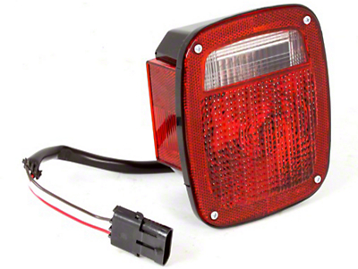 Omix-ADA Left Side Tail Light W/ Black Housing (87-90 Wrangler YJ)