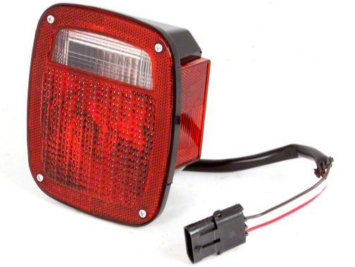Omix-ADA Right Side Tail Light W/ Black Housing (87-90 Jeep Wrangler YJ)
