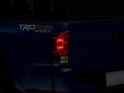Toyota TRD Pro Tail Light; Black Housing; Clear Lens; Driver Side (16-21 Tacoma)
