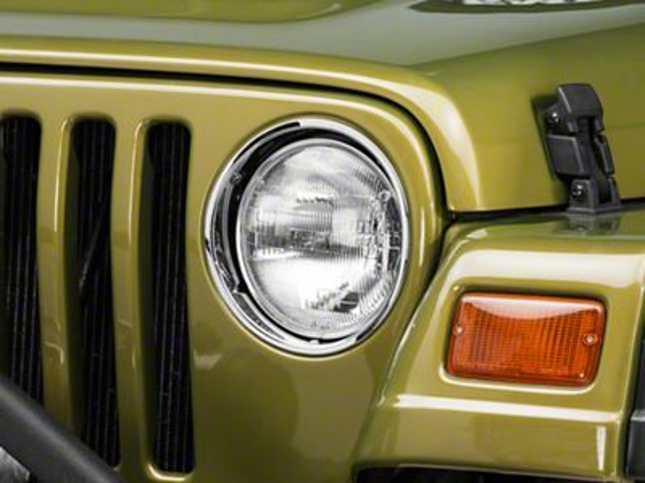 Omix-ADA Driver Side Headlight Bezel (97-06 Jeep Wrangler TJ)