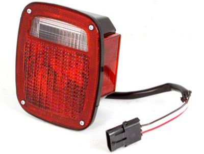 Omix-ADA Right Side Tail Light W/ Black Housing (87-90 Jeep Wrangler YJ)